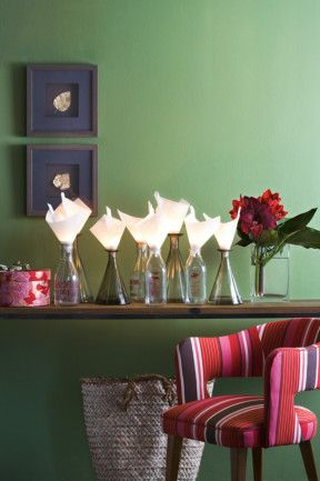 Traditional red and green Christmas decoration Tealights, baking paper and a mass of bottles make for a glowing display, or try a series of bowls filled with red or green foil-wrapped sweets: the kids will love it.