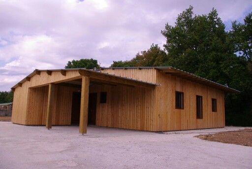 Maison ossature bois, bardage mélèze ajouré Construction maison - construire son garage en bois