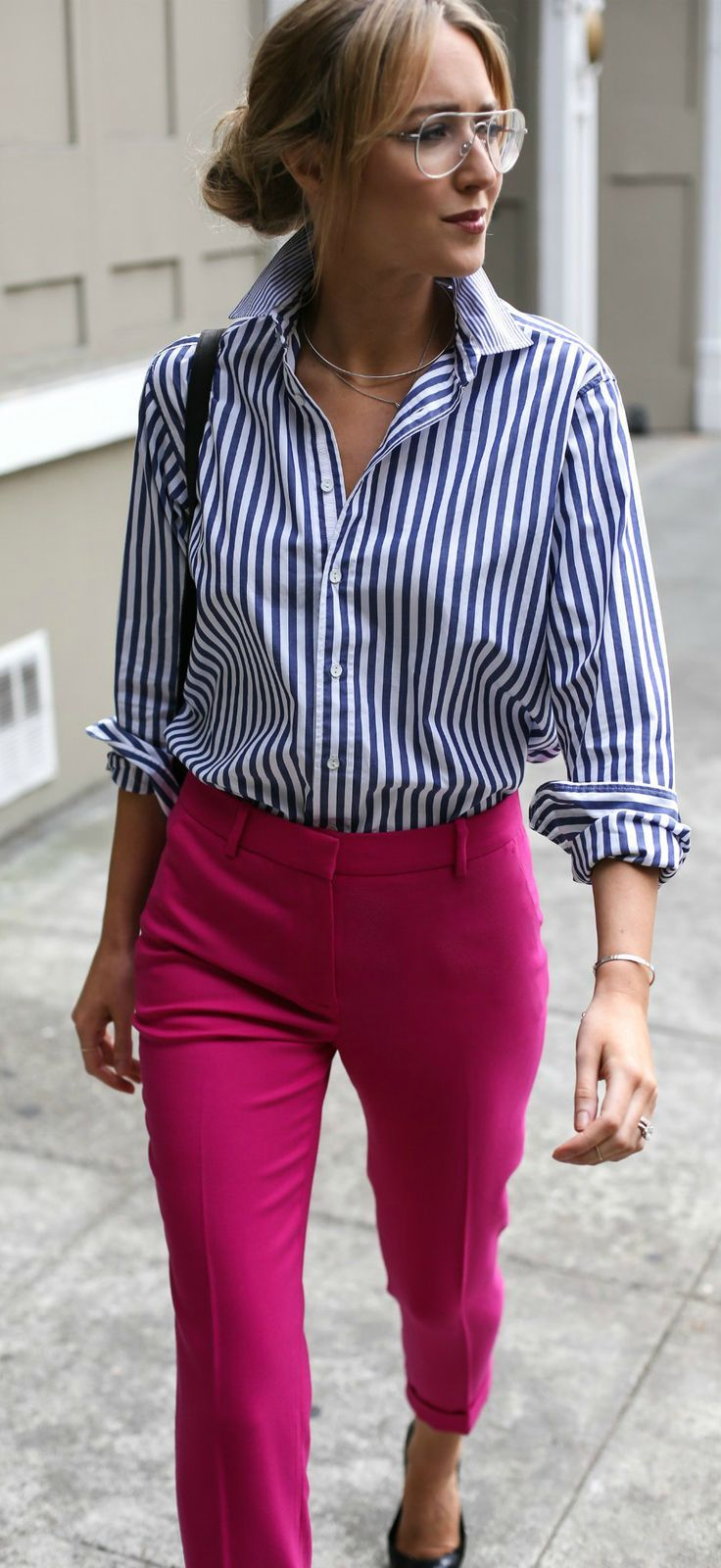 2ddbad299aa How to wear bright colors at the office with these fuchsia pink pants, navy  and white striped boyfriend shirt and classic black pumps!