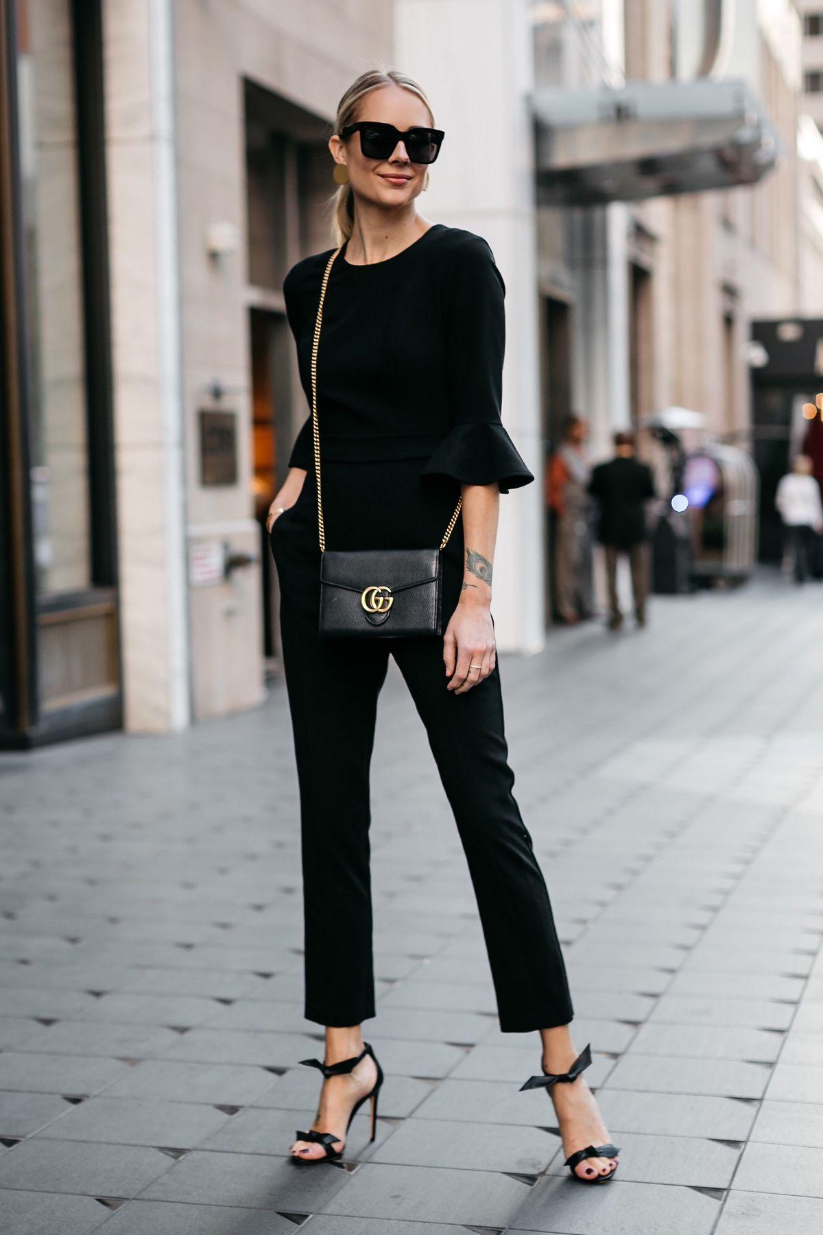 33ebcdf1d51d8 Blonde Woman Wearing Black Ruffle Sleeve Jumpsuit Gucci Marmont Black  Handbag Black Bow Tie Heels Gold Disc Earrings Black Celine Sunglasses  Fashion Jackson ...