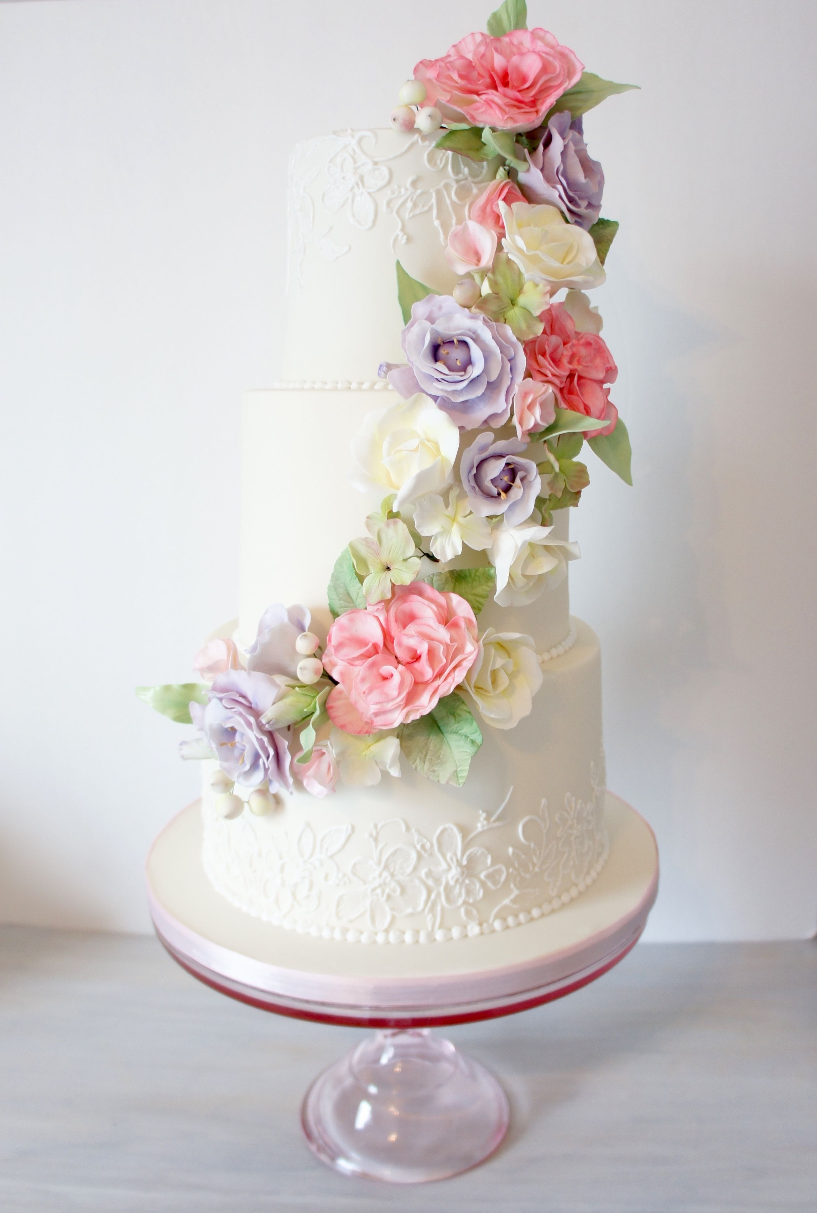 Spring sugar flowers! Wedding cake with floral cascade and ...