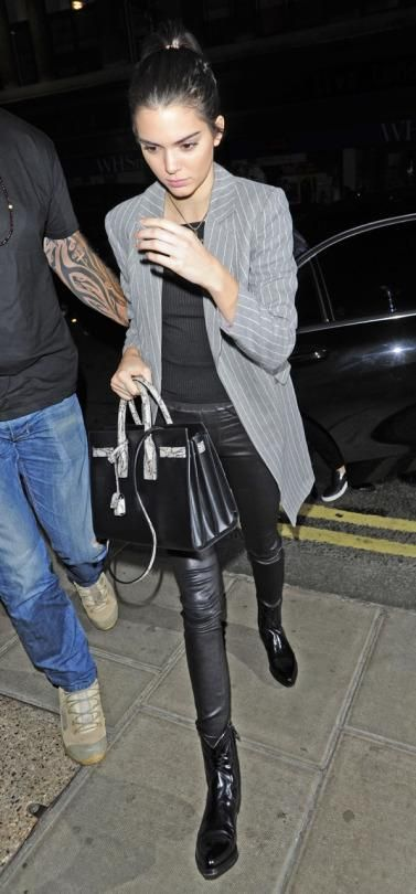 Kendall Jenner wearing Helmut Lang Faux-Pocket Leather Leggings, Saint Laurent Leather Santiag Ankle Boots, Saint Laurent Sac De Jour Small Leather and Snakeskin Tote, Nasty Gal Off and on Ribbed Crop Top and Helmut Lang Stretch-Leather Leggings