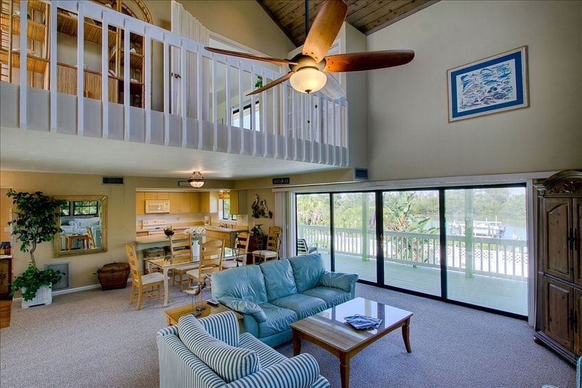 waterfront villa pool dock stroll to beach instant full