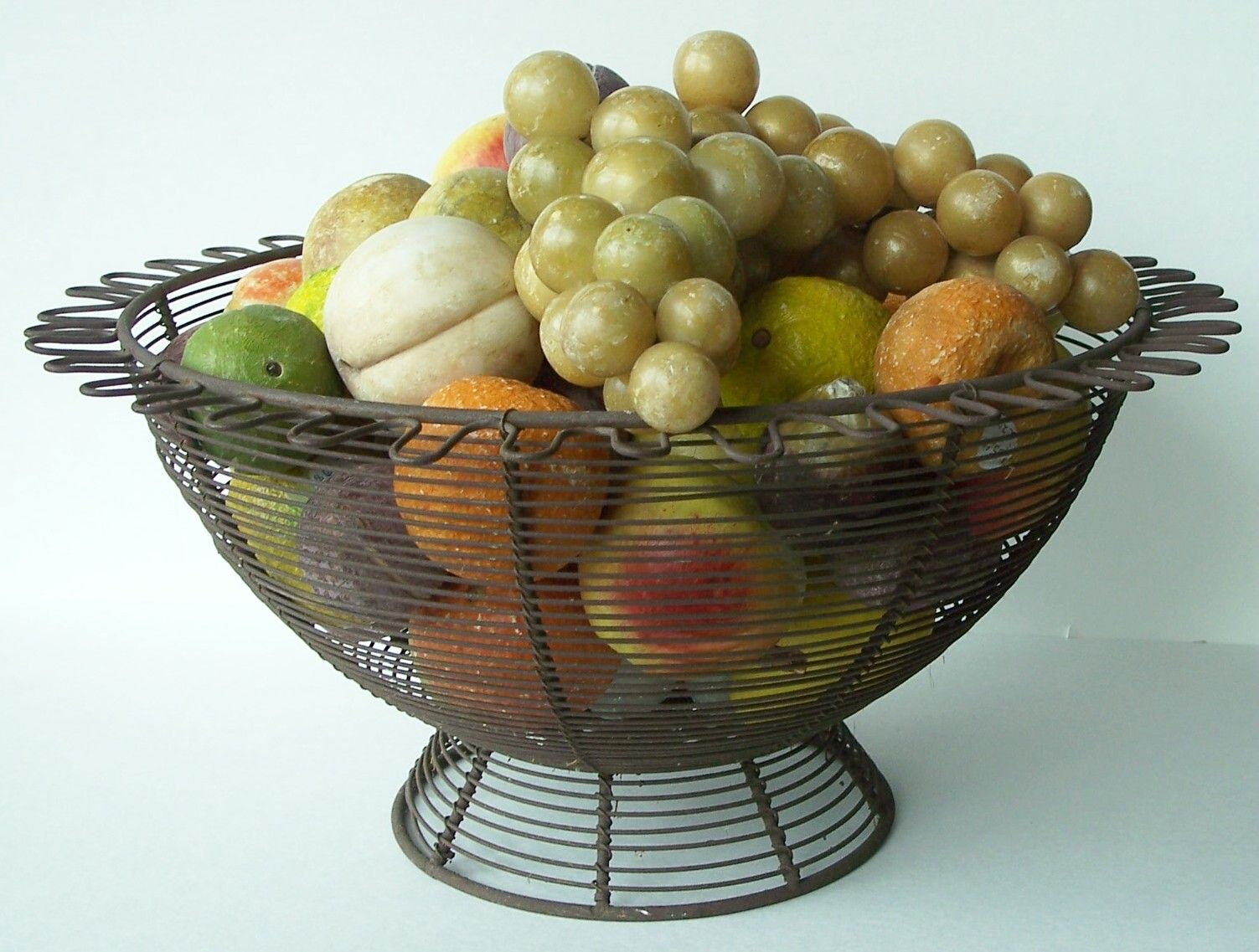 Late 19th century handmade beautiful wire basket, was designed for holding Fruit .  Country Treasures    www.mycountrytreasures.com