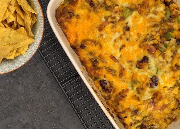 Dig into a plate of cheesy nachos loaded with smoky chilli for your next party. Selasi Gbormittah's recipe is so easy to make