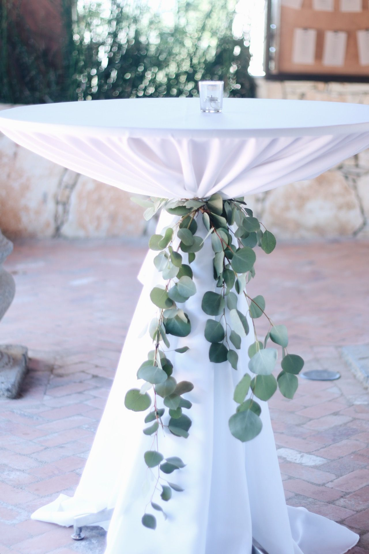 Eucalyptus cocktail table ties are such a lovely element for Floral table decorations for weddings