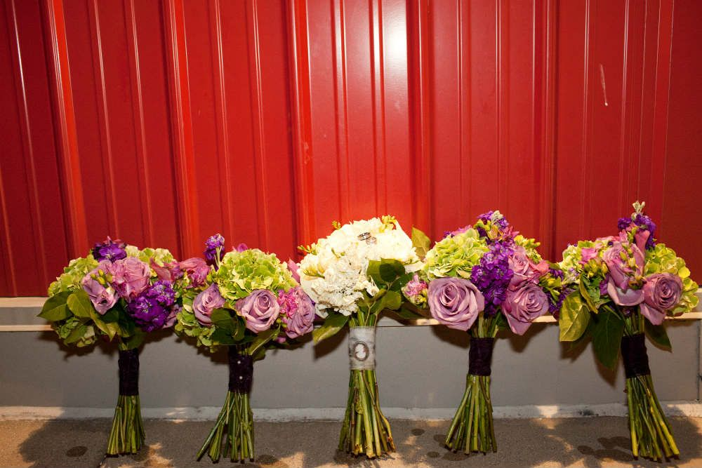 Bridal party bouquets outside the barn