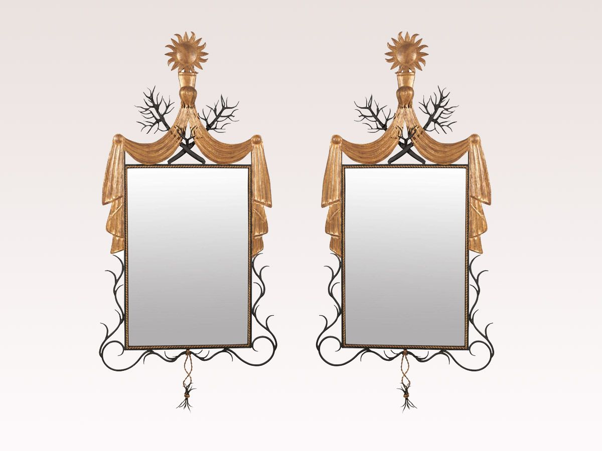 An American Contemporary Carved Mirror with Iron Frame, Antiqued Glass, Thorny Branches and Sun Carving at the Crest Sitting on a Swag Motif. 2 Available, Priced and Sold Separately.