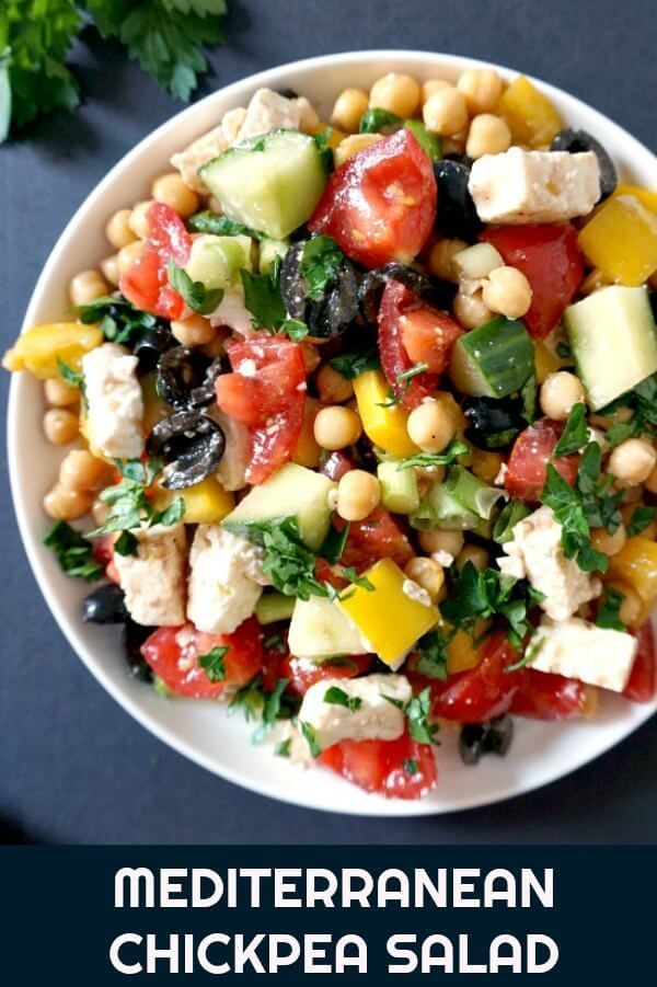 Mediterranean Chickpea Salad with Feta, a healthy salad for any season. It has a light dressing that gives the ingredients a boost of freshness and extra taste. Low carb, vegetarian, great for the whole family, this easy salad can be made in under 5 minutes. The perfect side to go with your Bbq or roast. , , , ,
