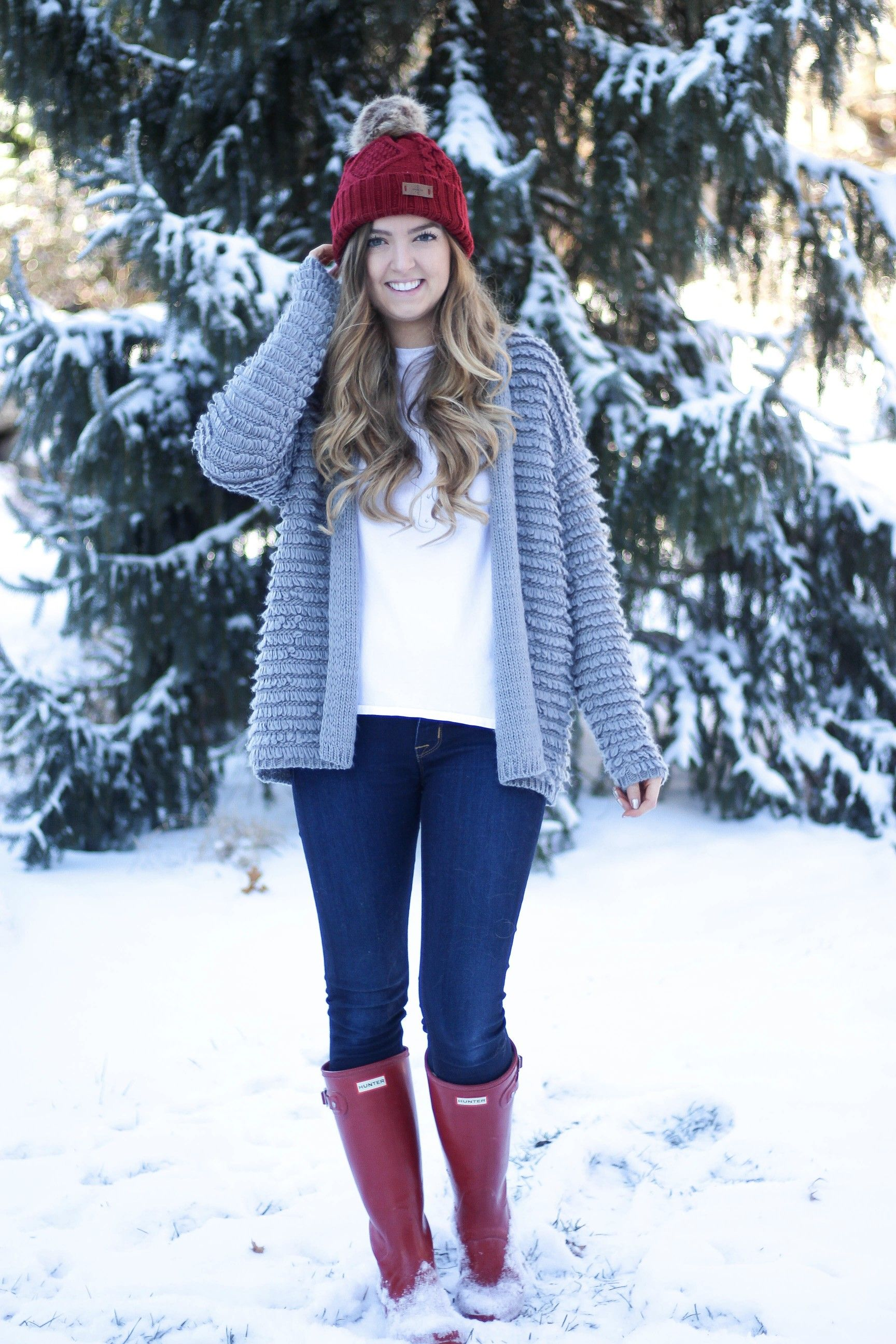 Cactus wearing a Santa hat t-shirt with an adorable textured cardigan. Paired with red hunter boots and a red beanie that is only $12! My favorite Christmas outfit, holiday outfit, and winter outfit! By Lauren Lindmark on Daily Dose of charm dailydoseofcharm.com