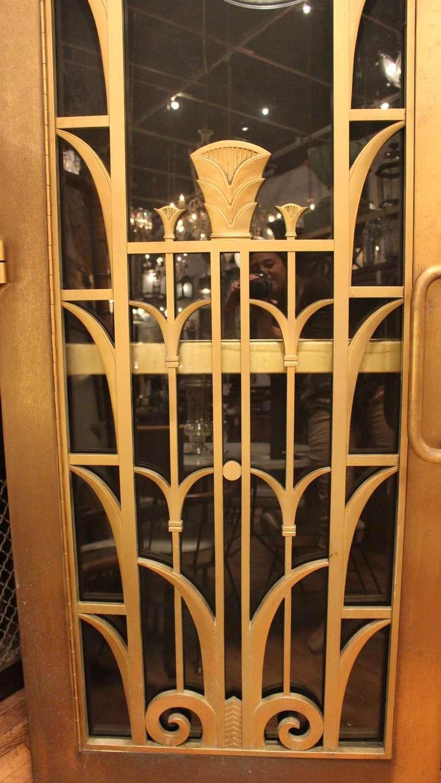 Art deco brass double door set from a manhattan university door