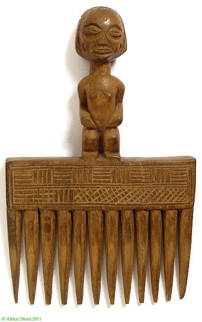 Title: Chokwe Figural Comb with Female Figure on Top Africa   Type of Object: Comb   Ethnic Group: Chokwe  Country of Origin: Democratic Republic of the Congo, Angola  Materials: Wood   Approximate Age: 20th Century