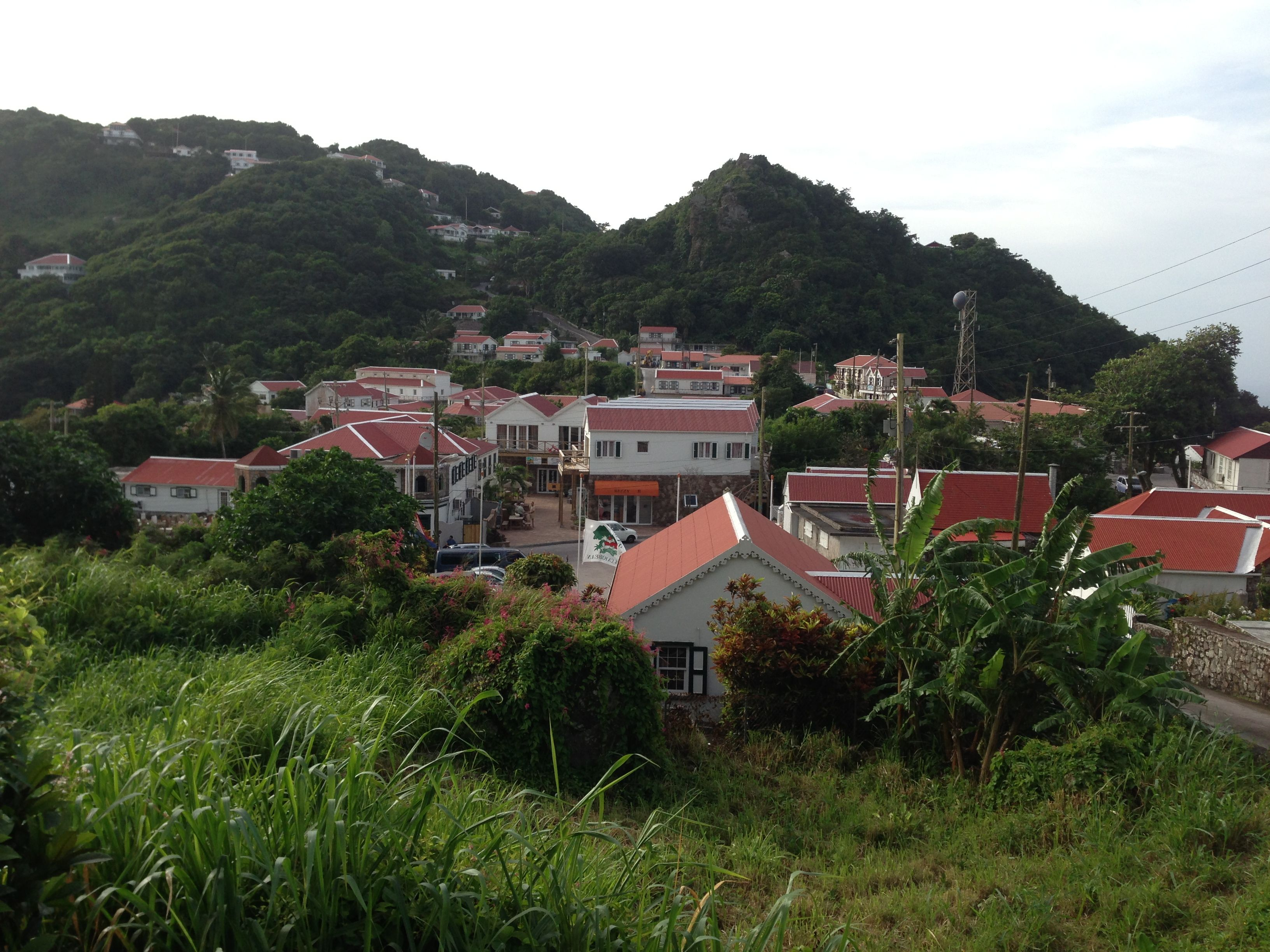 On Saba, all the houses look the same. Pretty white cottages with red  roofs, green shutters and perhaps a small white gate. It's part of the  island