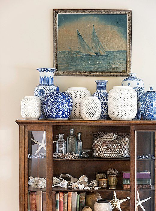 A china hutch that belonged to one of Matthew's grandmothers has pride of place in the living room and is filled withblue-and-white porcelain from his othergrandmother, antique books, and shells heand his husband have amassedover the years.