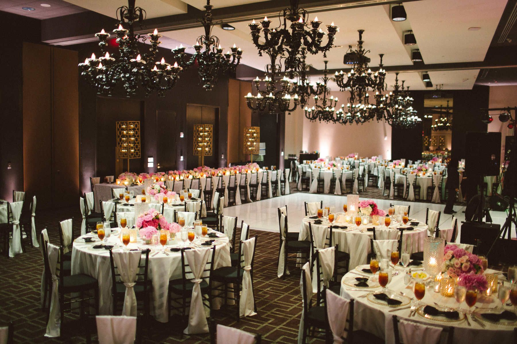 I just love this reception room with the black chandeliers hotel sorella planning by en vogue events our white imperial stripe linens make a dramatic statement for this modern wedding with black bow tie napkins junglespirit Choice Image