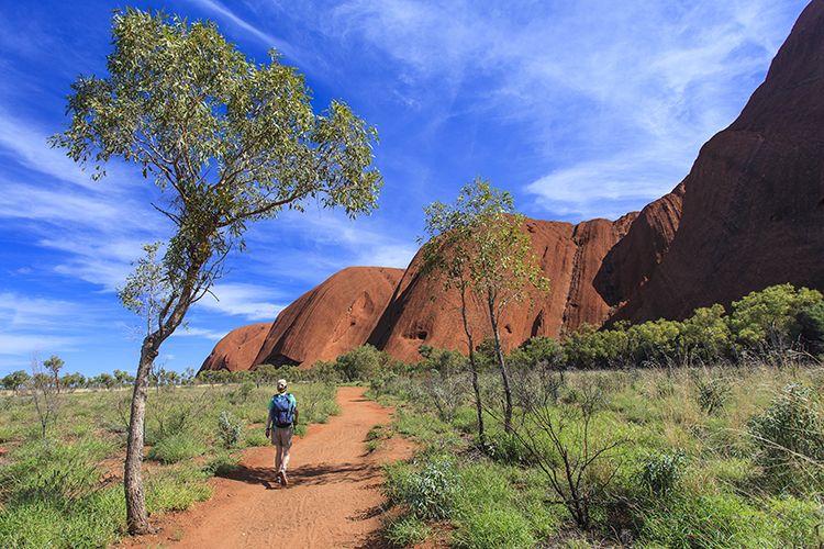 A hiker approaching the southeastern side of Uluru