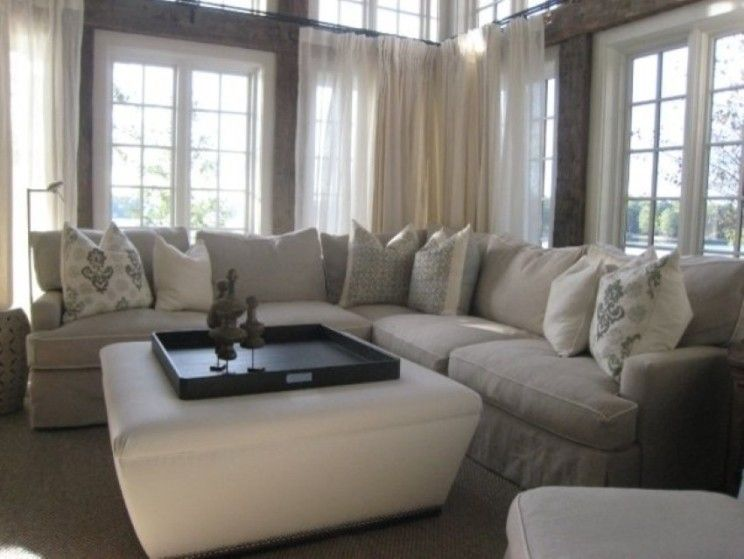 Stylish Light Grey Sectional Sofa With White Ottoman Completed With