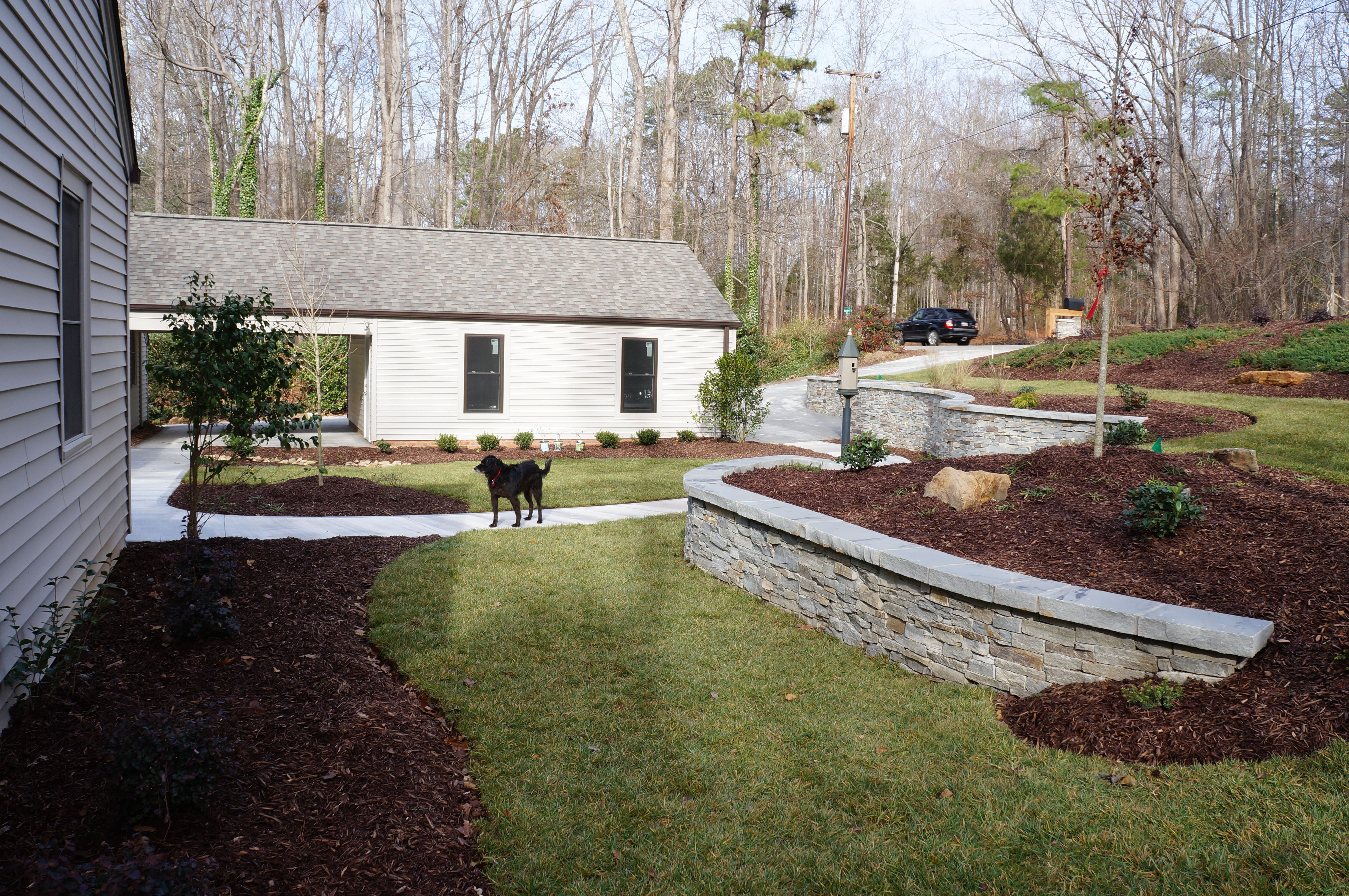 Real Rock Retaining Wall The Front Yard At This Home