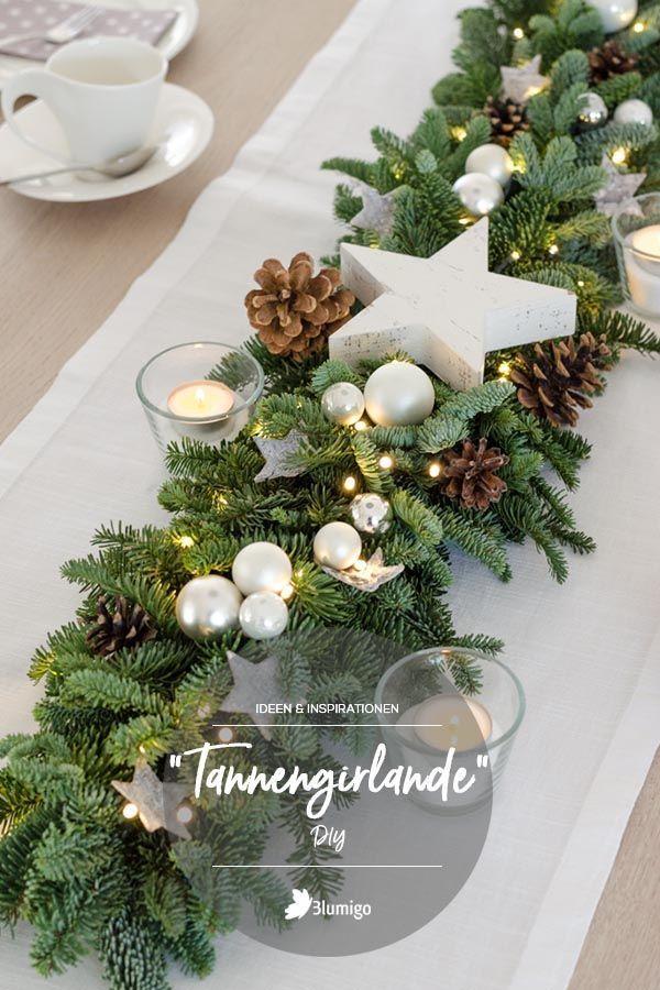 Tannengirlande mit Lichterkette selber binden – Weihnachtsdeko für eine  schöne Festtafel. DIY-Anleitung auf dem Blumenblog von Blumigo.de  #basteln #doityourself #Weihnachtsdeko #weihnachten #christmas   #dekoideen #tischdekoration #diyideen #diy #xmasdecor #xmas  #bastelanleitung #bastelideen  #naturdeko #anleitung #festtafel
