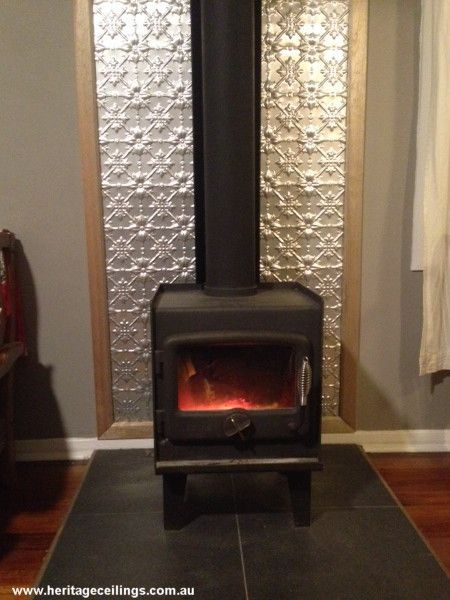 Pressed Tin Panels Used As A Fire Place Wood Stove