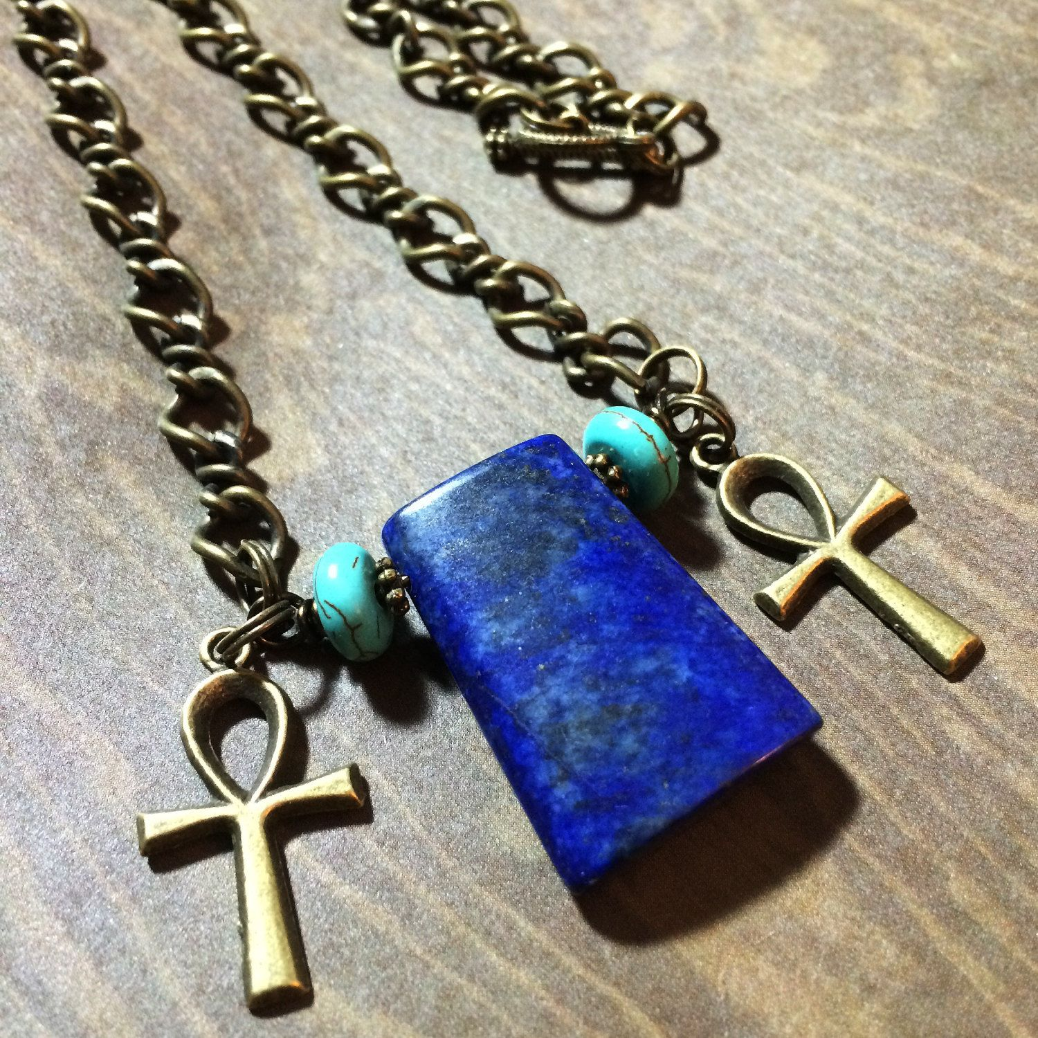 Lapis lazuli egyptian ankh necklace egyptian cross pendant inspired by ancient egyptian symbolism this antique gold chain necklace features an eye catching 1 buycottarizona Image collections