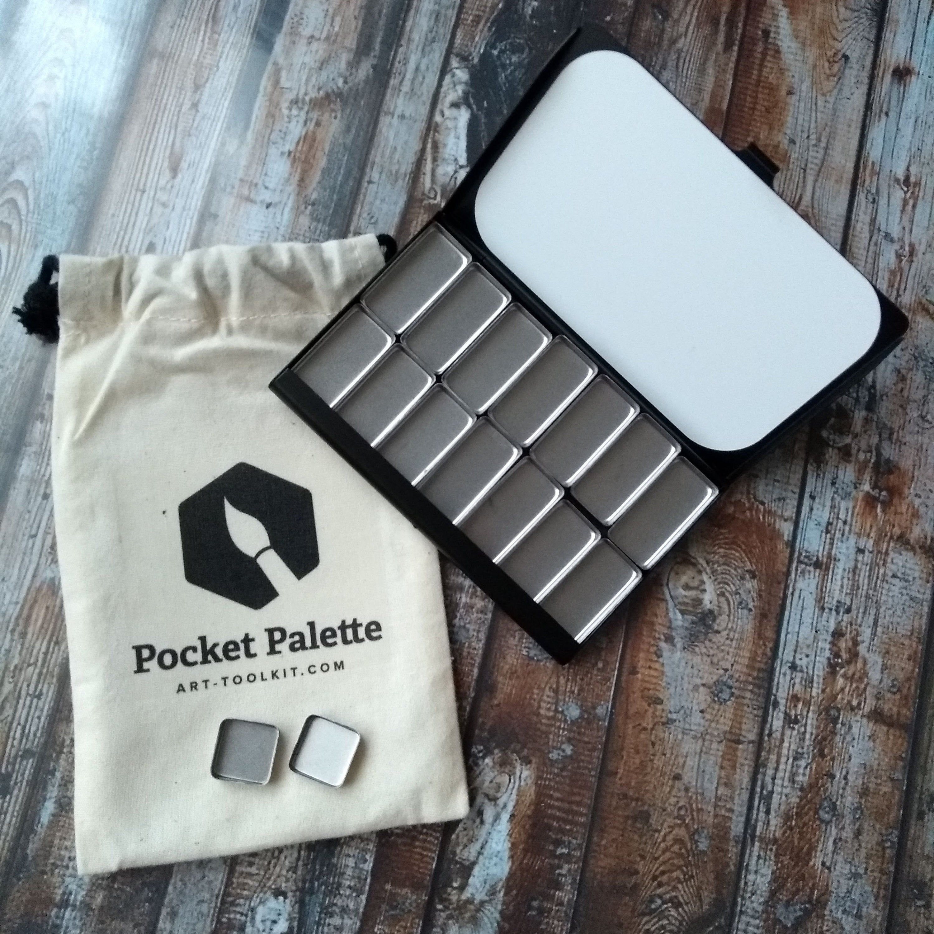 Black pocket palette with 14 stainless steel pans on a