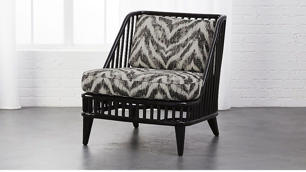 Kaya black rattan chair with zebra print cushions cb2