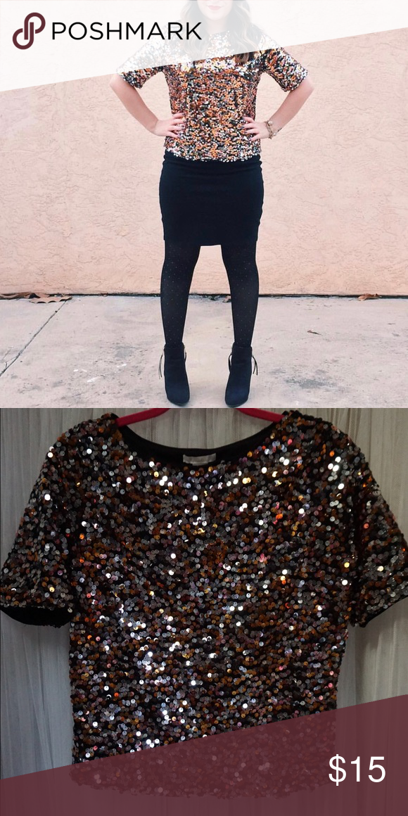 Sequin top Short sleeve multi colored metallic sequin top. Sequins are gold, silver & bronze. Worn once. H&M Tops Blouses