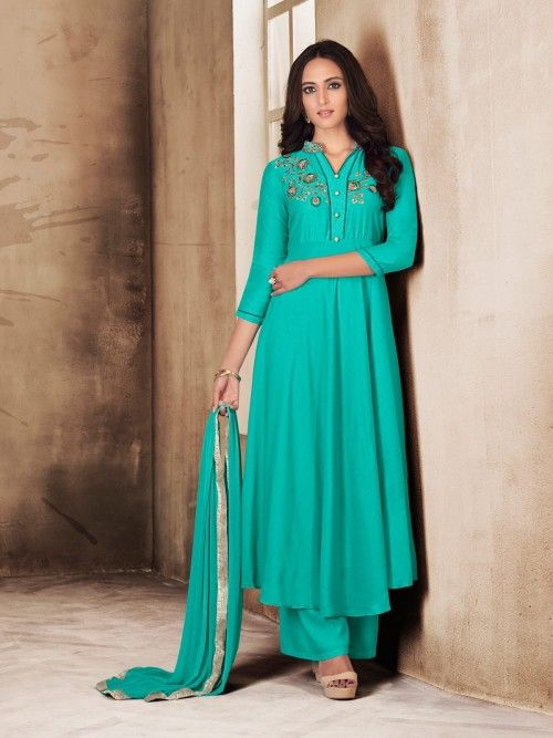 b20c6a1a40 Marvellous aqua blue casual palazzo suit online which is crafted from  maslin fabric with exclusive embroidery. This stunning casual palazzo suit  comes with ...