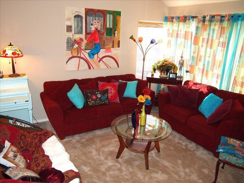 Living Room Maroon Sofa Blue Cushion Stand Light Round Coffee Table Yellow Flower Vase Curtain