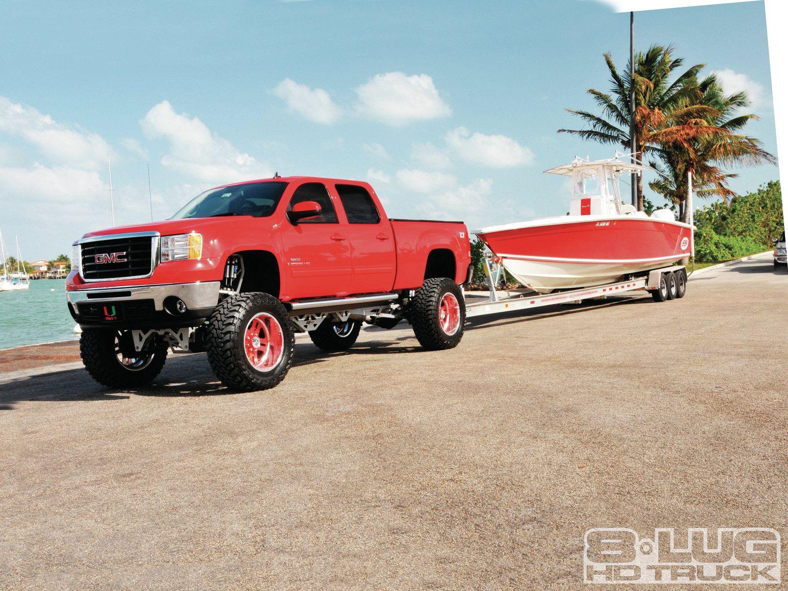 Lifted 2010 gmc sierra 2500 hd pulling boat trailer