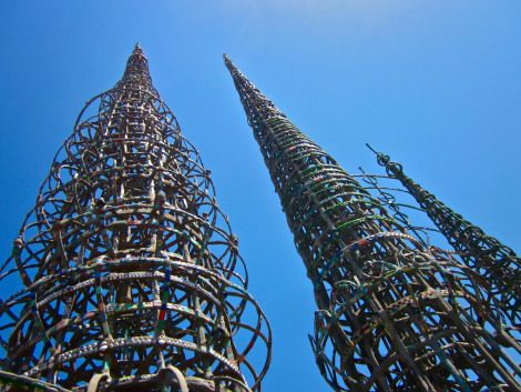 Watt's Towers  Simon Rodia, an Italian-American, spent a big portion of his later years building these tall structures in his backyard. The tallest tower is 99 1/2 feet tall, right below the city height limit. He created them all by himself out of clay, bottles, and broken dishes he bought from his neighbors.