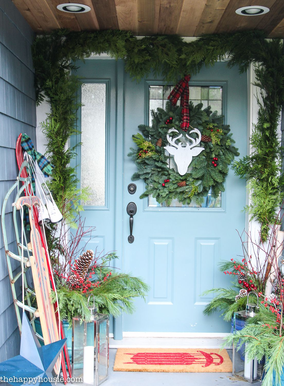 thrifty classic christmas front porch decor love the wood paneling on the ceiling too the happy housie - Christmas Front Porch Decorations Pinterest