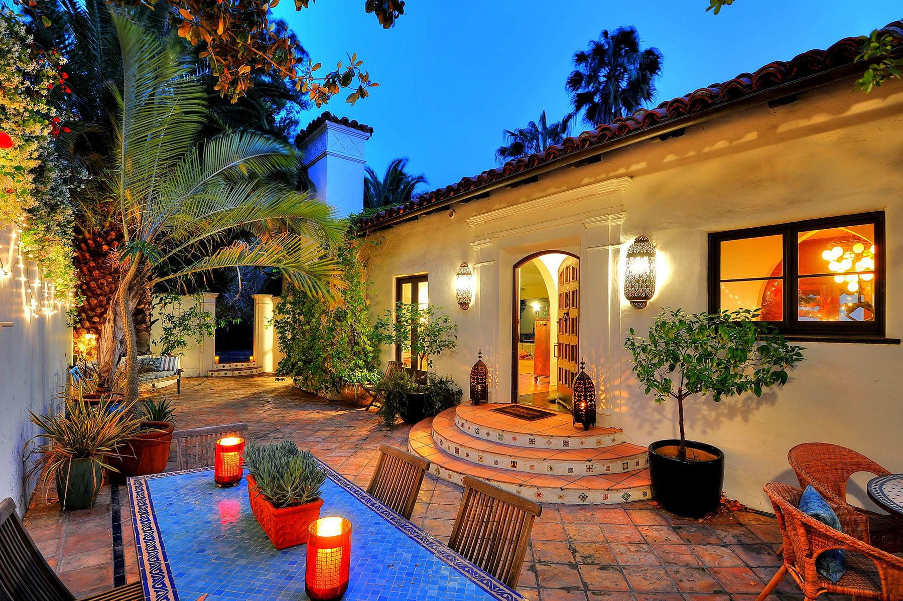 Mediterranean patio design by los angeles design build hartmanbaldwin - Love The Lanterns And The Potted Trees Decoration Spanish Style House With Decorative Candles Spanish Style Homes With Its Interior Design