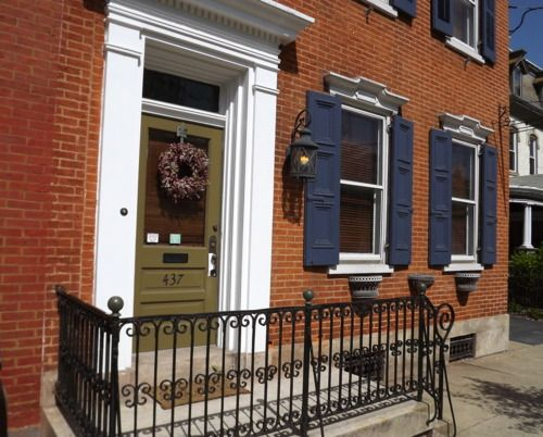 Shutter colors for red brick playful door colors work even on homes with more sophisticated - Red brick house black shutters ...