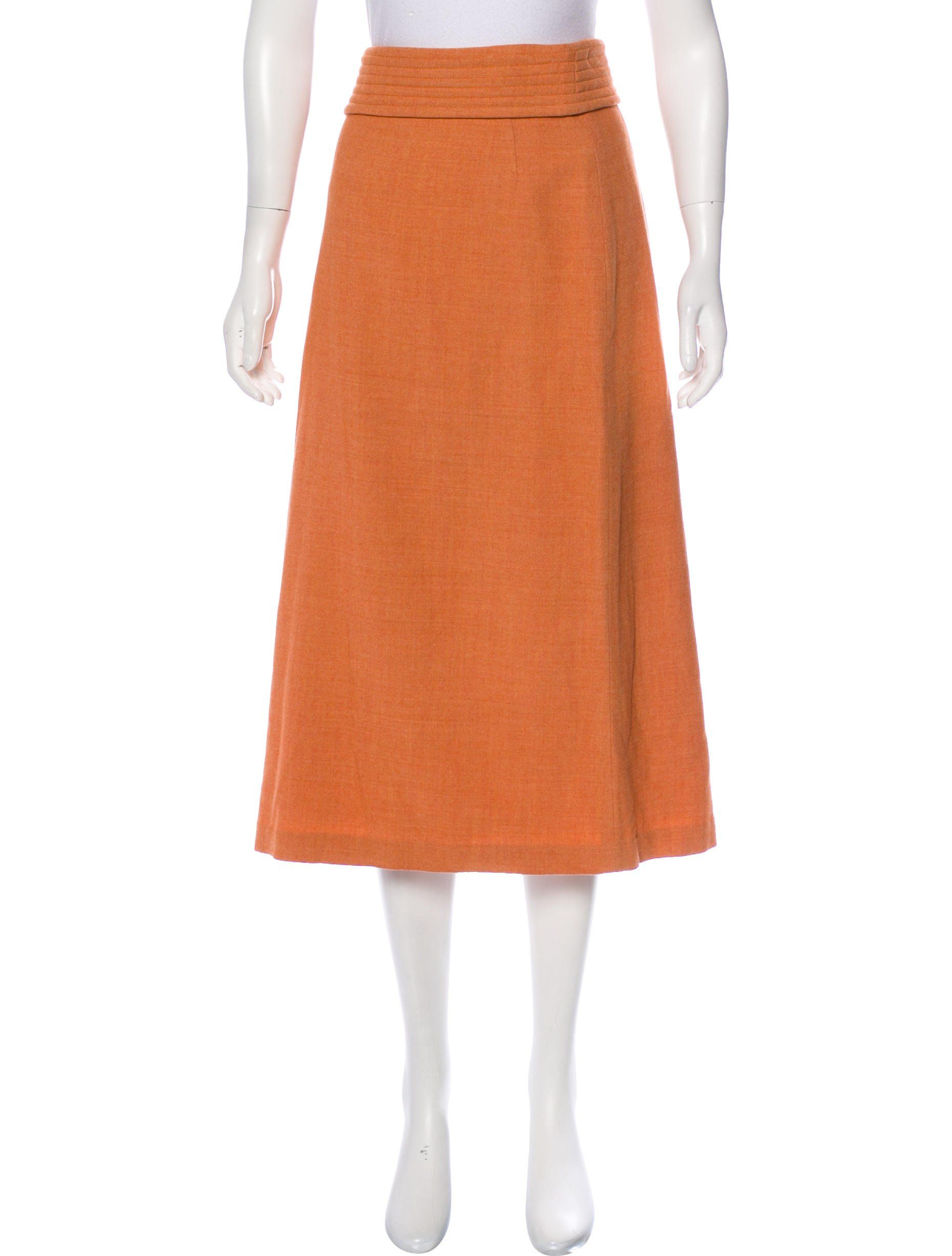 732b56da0bdc Orange Dries Van Noten A-line midi skirt with tonal stitching throughout,  pleated overlay at waist and concealed zip closure at back.