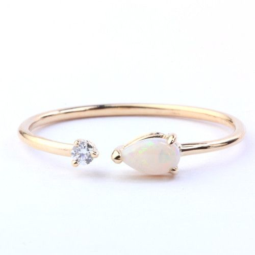 6b1a78aeb MIMI RING   A PEAR CUT OPAL MEETS A TINY DIAMOND IN THE CENTER OF A DELICATE  OPEN RING