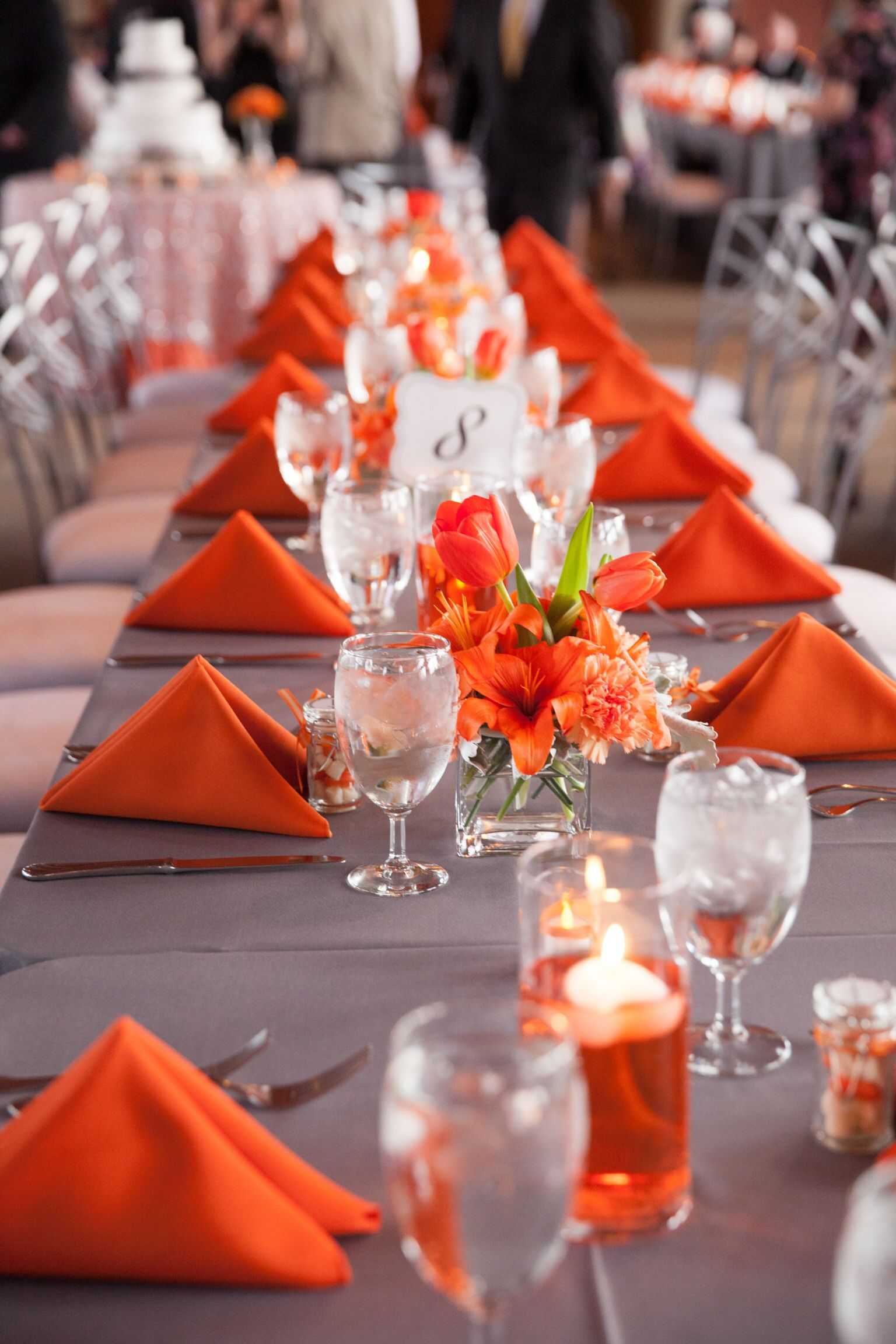 gray and orange wedding. simple centerpieces for long