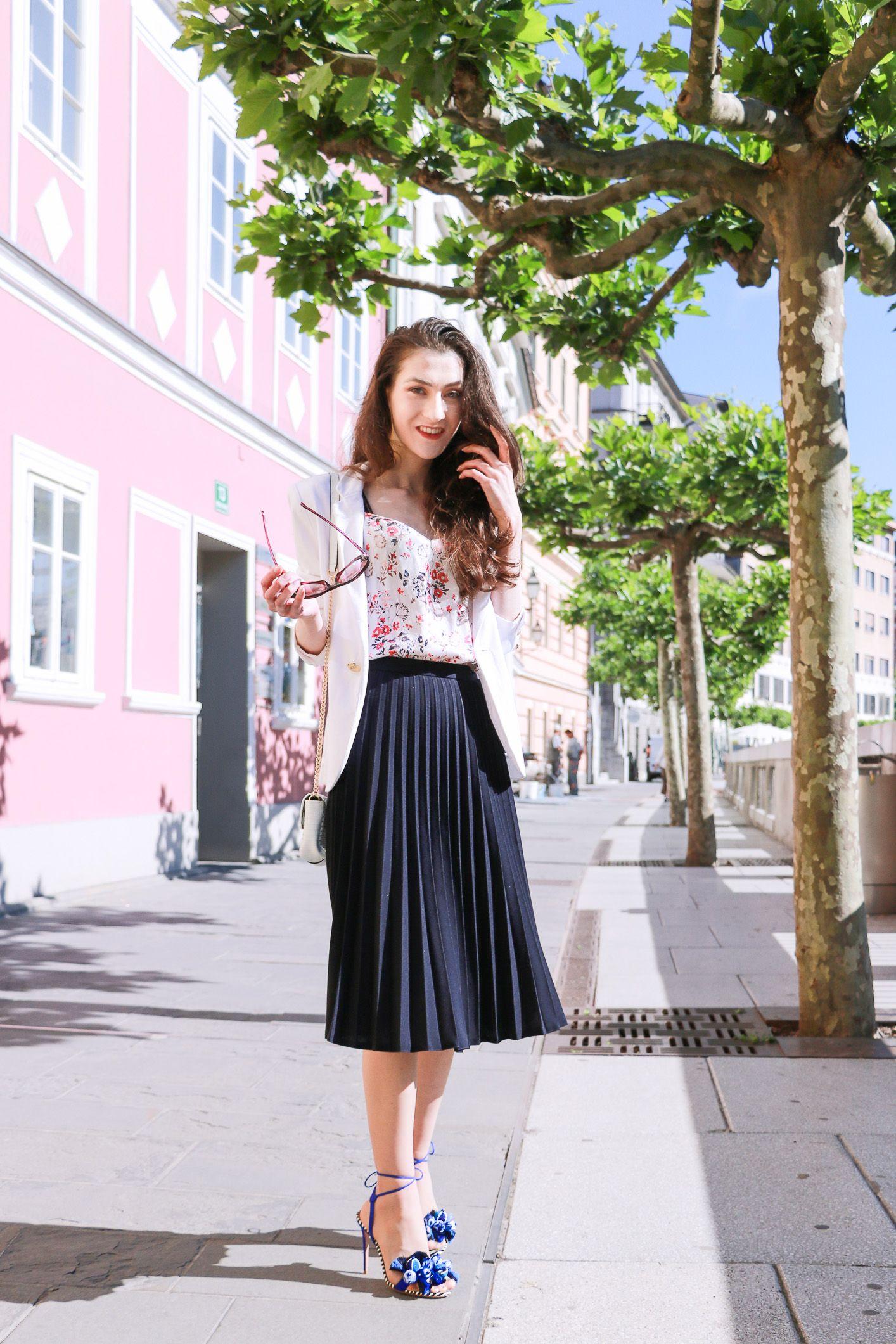 645bd4617a Fashion blogger Veronika Lipar of Brunette From Wall Street sharing how to  wear black vintage midi pleated skirt, blue Tropicana tasseled beaded  sandals ...