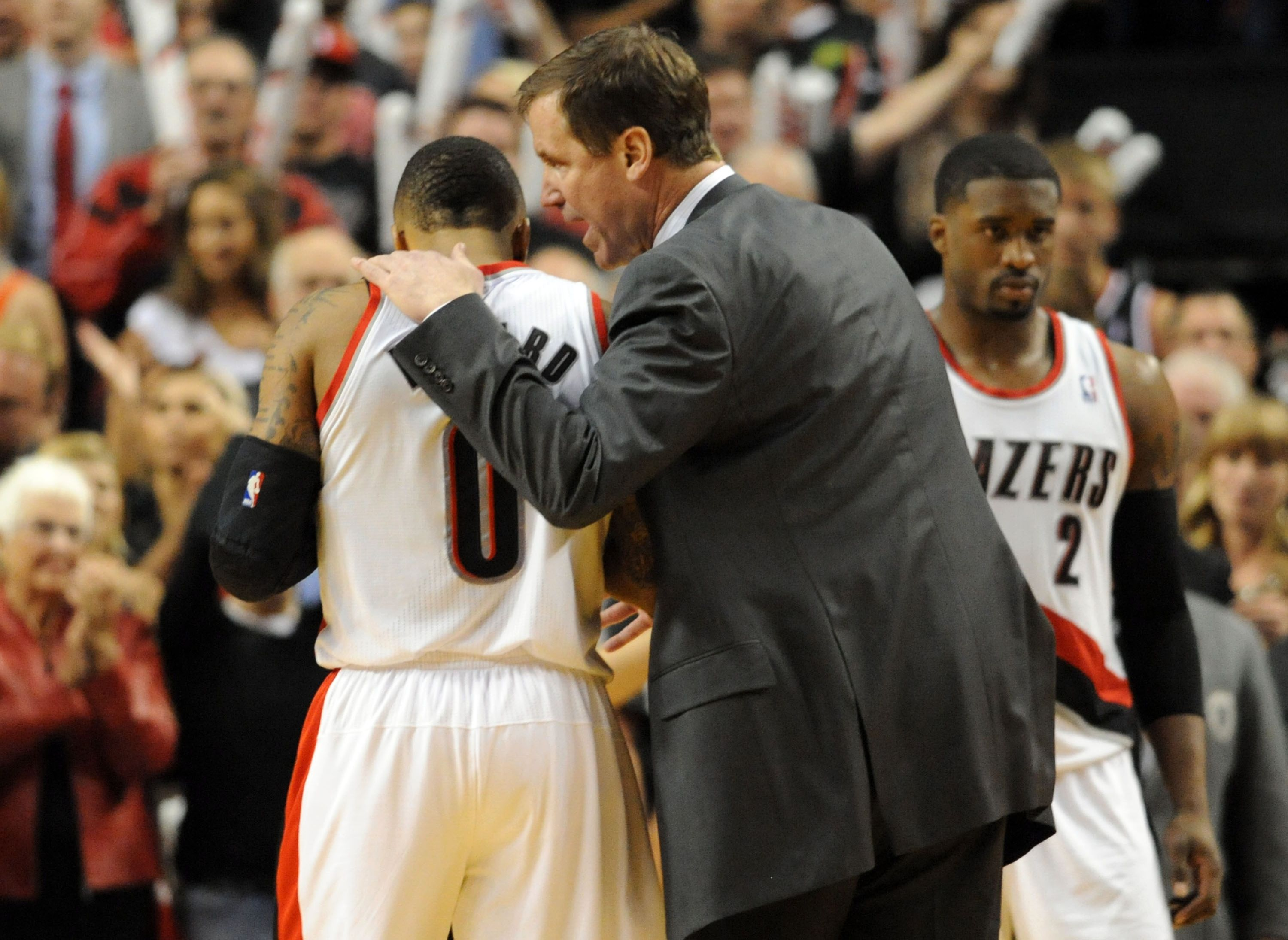 MAY 2: Terry Stotts of the Portland Trail Blazers has some words with Damian Lillard #0 of the Portland Trail Blazers late in the fourth quarter of Game Six of the Western Conference Quarterfinals against the Houston Rockets during the 2014 NBA Playoffs at the Moda Center on May 2, 2014 in Portland, Oregon.