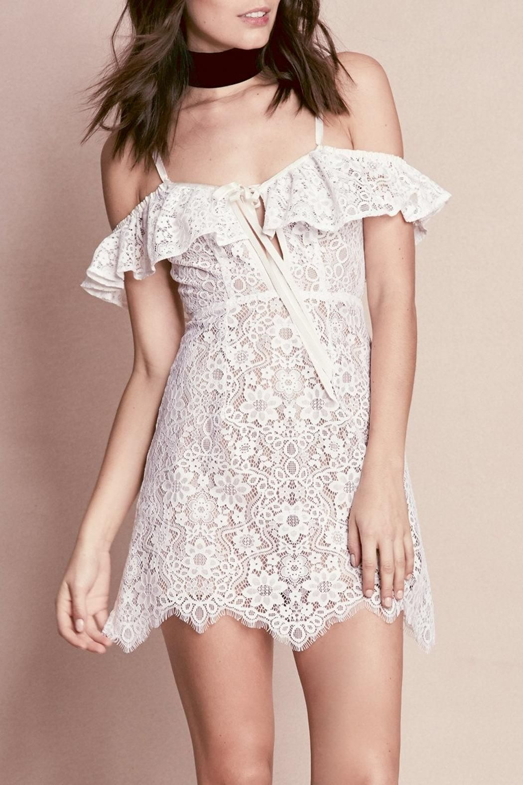 Freshen up your look this summer with the Rosemary Mini Dress. This beautiful mini features a two-tone custom floral ivory lace with off-the-shoulder ruffles and boning in sides to flatter your figure. This little lady was designed to show off your legs with the subtle a-line hem. Don't worry about coverage because this little mini is fully lined! Details feature two-tone custom floral lace, elasticated off the shoulder ruffles, bodice has deep v, slight a-line scallop hems and it is fully…