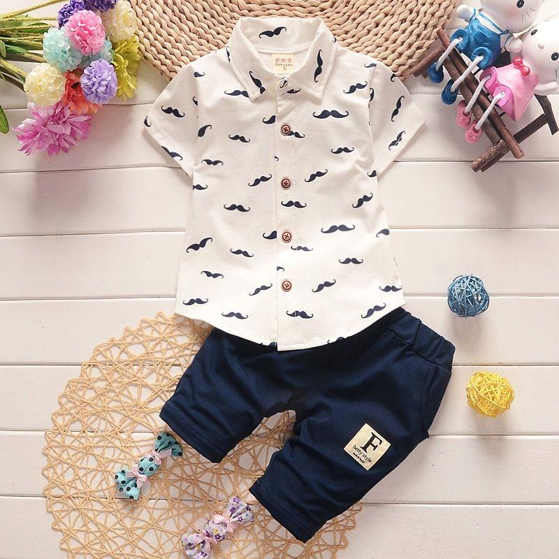 Moda hombre fijaron la ropa del verano del bebé del algodón niños camiseta  + Pantalones cortos 2 unids traje niños de dibujos animados traje casual 3  años b2fb3e2df3c