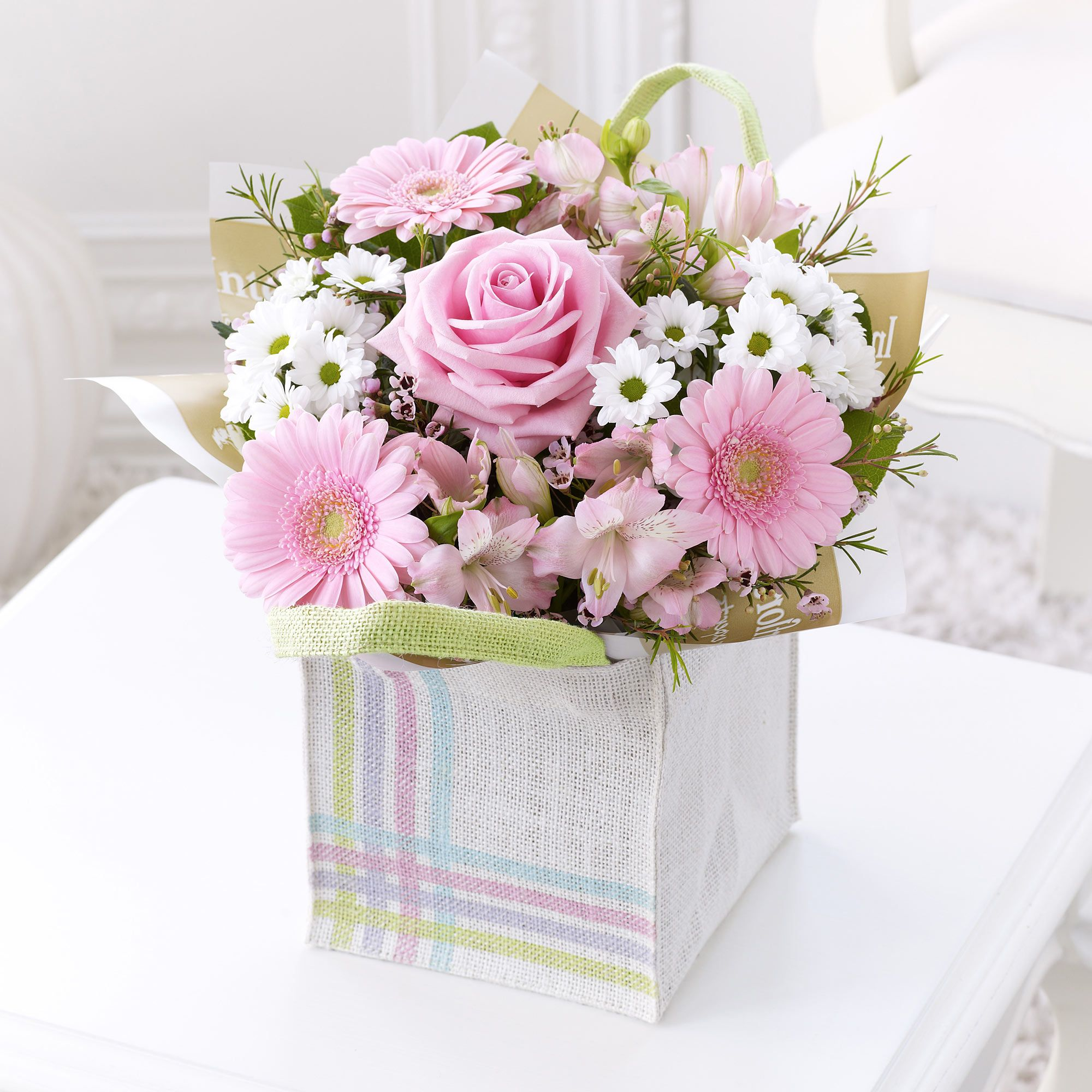 This gift bag arrangement contains pink alstroemeria pink germini ie has the largest branch network of florists in ireland send flowers with flowers flower delivery available in dublin and nationwide izmirmasajfo Gallery