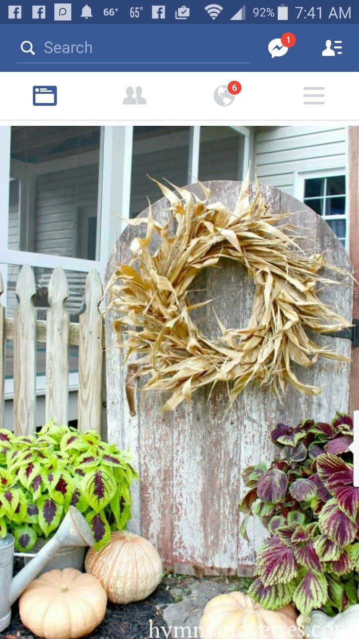 How to make your own rustic corn husk wreath using corn shocks from the  farm market, a simple wire wreath frame, and a paddle of wire.