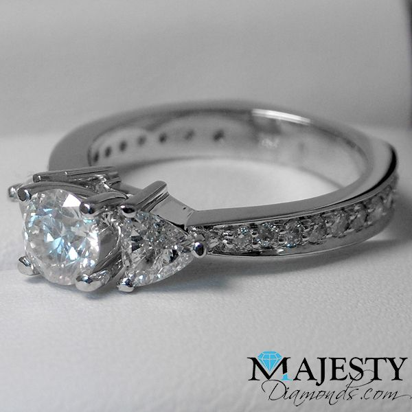 Round cut diamond engagement ring with accent stones. Classy.