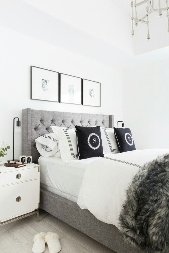 Black And White Photos Above Bed