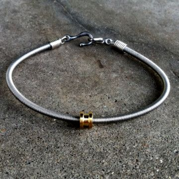 bass string bracelet made from recycled bass strings is a must have accessory for any concert. Black Bedroom Furniture Sets. Home Design Ideas