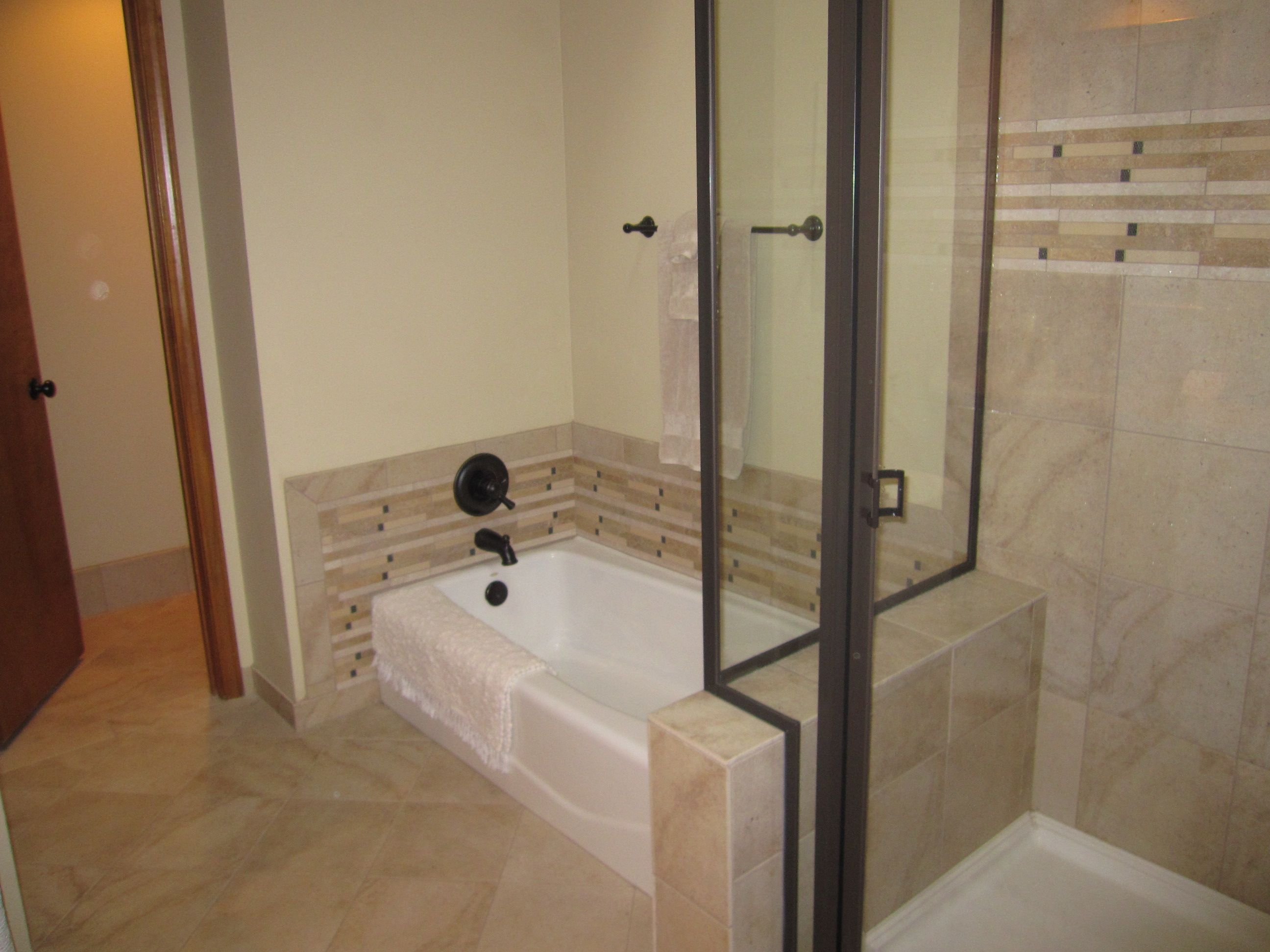 Bathtub shower doors bronze - Garden Tub With Matching Inlay To Shower With Custom Glass Doors And Tile Bench Oil
