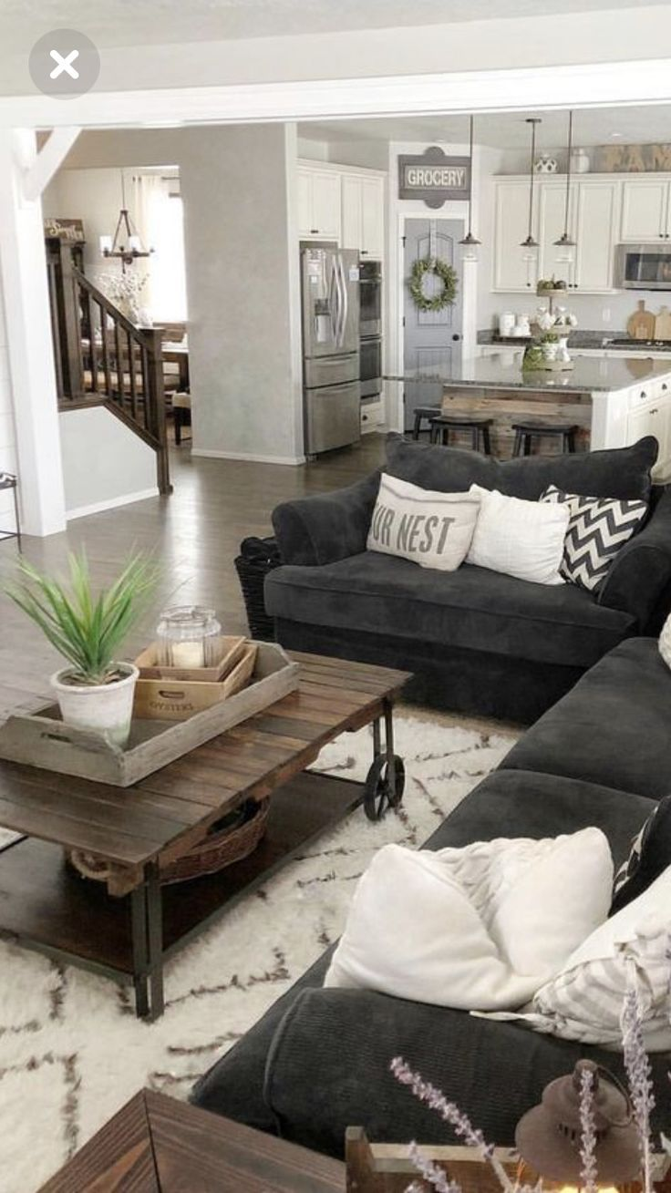 I love this cozy set up. Especially the dark couch. (With ...