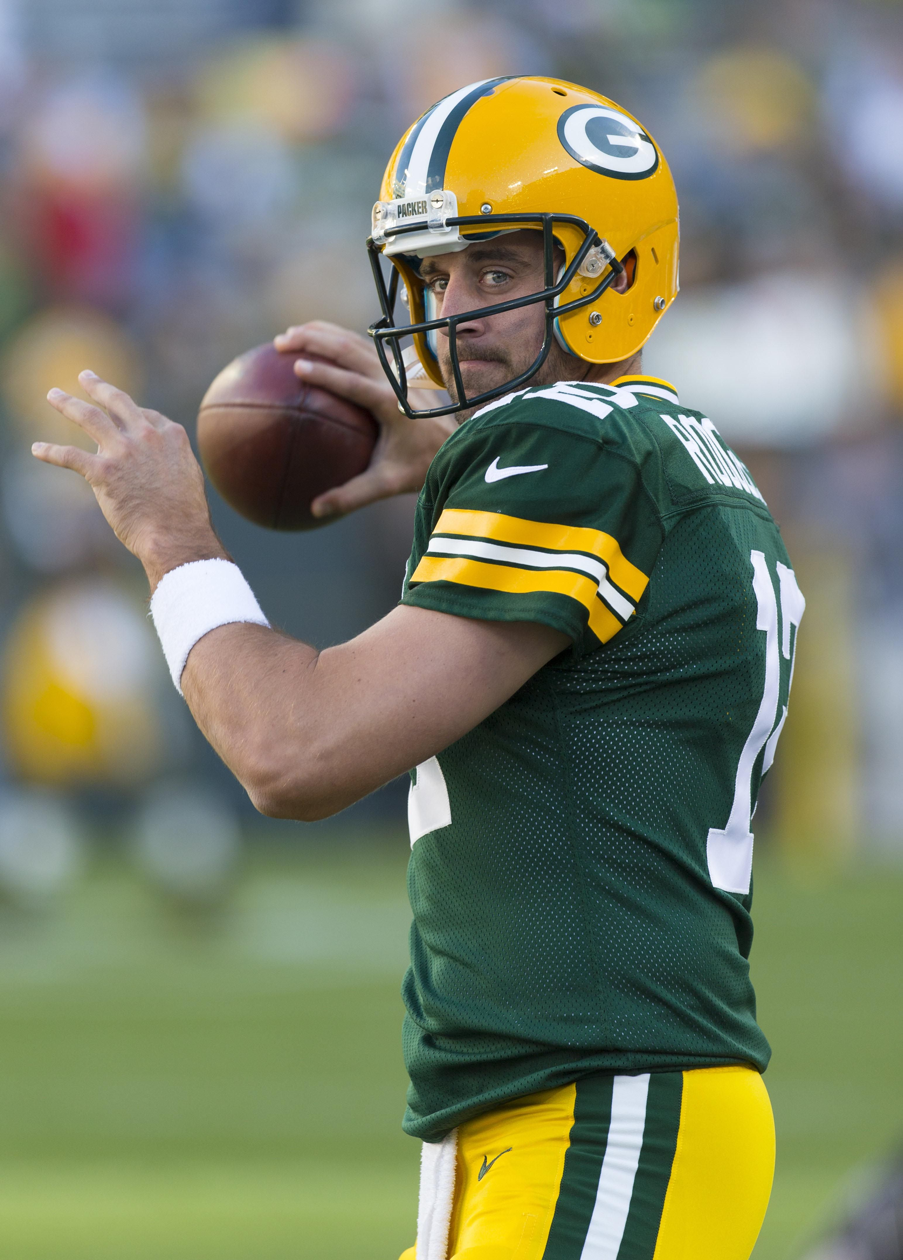 Green Bay Packers Quarterback Aaron Rodgers Throws A Pass During Warmups Prior To The Game Against T Green Bay Packers Team Green Bay Packers Arizona Cardinals
